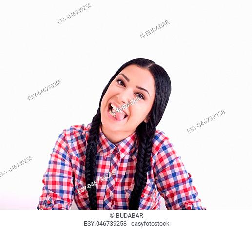 Pretty girl with two braids making silly faces with her tongue out. Isolated on white background