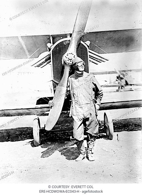 Pilot standing in front of U.S. Army airplane during World War I, circa 1918