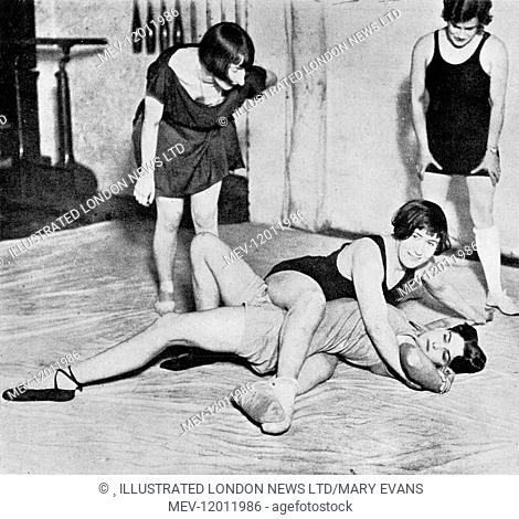 Members of a wrestling club for women, opened in Vauxhall, London in 1928. Miss Dot Butler, the school's champion wrestler