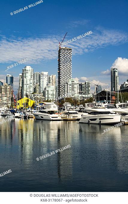 downtown apartment buildings, including Vancouver House, centre and the marina at Granville Island on False Creek Vancouver, BC, Canada