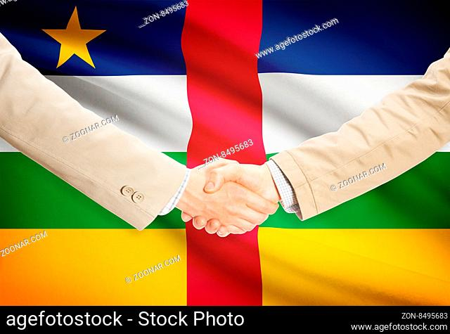 Businessmen shaking hands with flag on background - Central African Republic