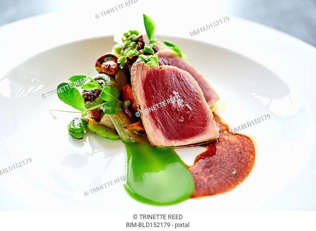 Close up of plate of tuna and sauce