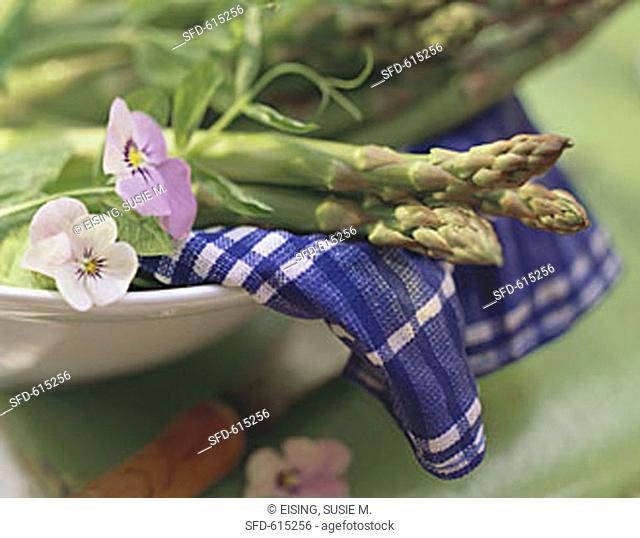 Close Up of Asparagus in a Bowl with Pansies