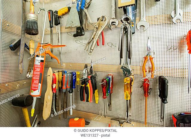 Tilburg, Netherlands. Tools hung neatly on a board in the workshop of a furniture upholstery