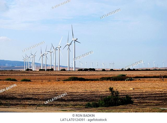 There is a row of wind turbines near the whitewashed village or pueblo blanco of Vejer de la Frontera. Many winds farms can be found along the Costa de la Luz