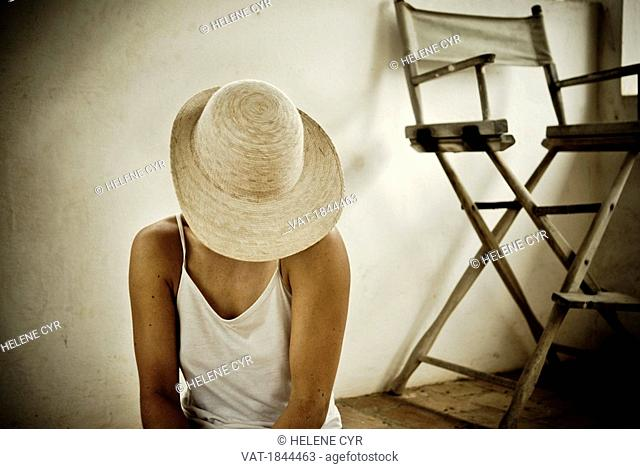 Mexico, Woman covering her face with hat