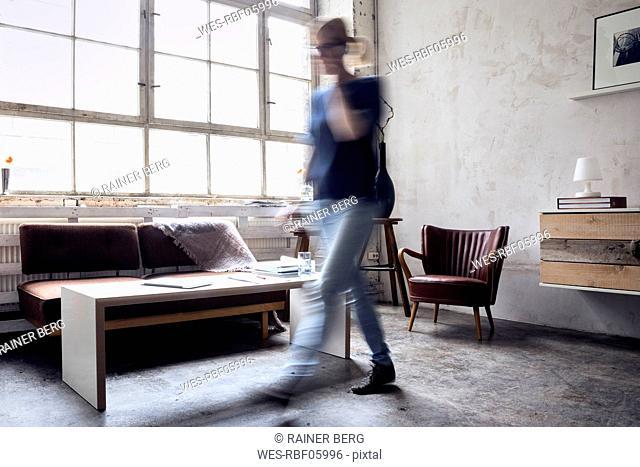 Woman walking in a loft