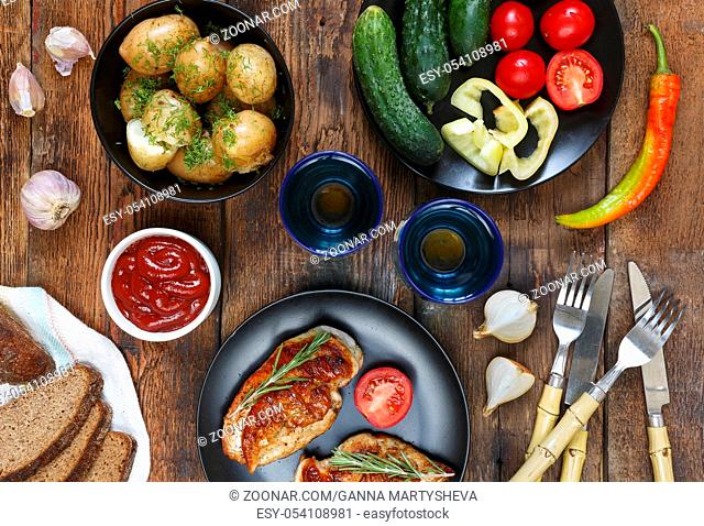 Dining table with various snacks and dishes, top view. The concept of authentic food, home cooking