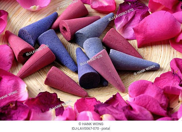 Incenses near rose petals