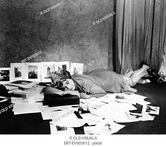 Woman asleep on floor surrounded by illustrations All persons depicted are not longer living and no estate exists Supplier warranties that there will be no...