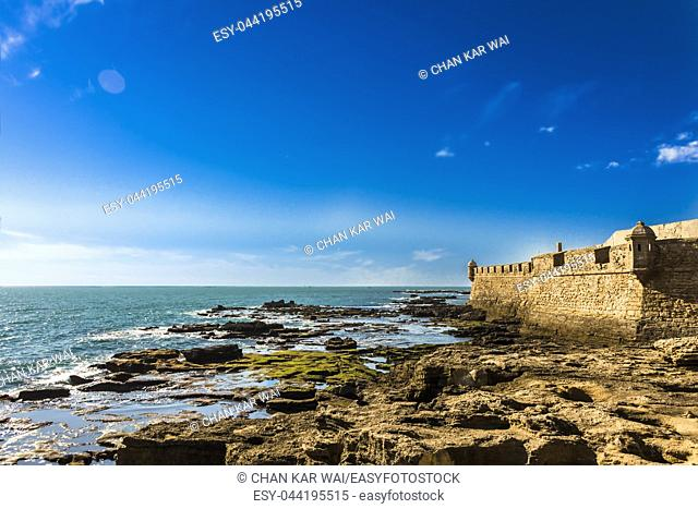 Moss covered rocks off the coastline of Castillo de San Sebastian in Cadiz