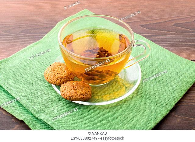 Cup with green tea on a wooden table