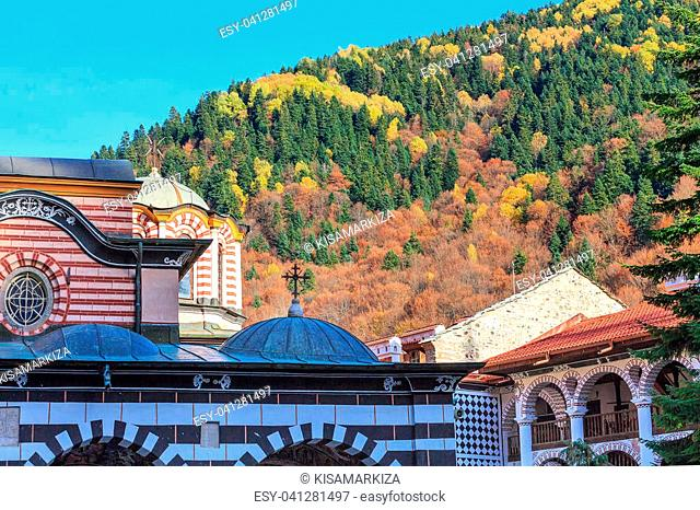 Rila monastery details close-up and autumn mountain trees at background, Bulgaria