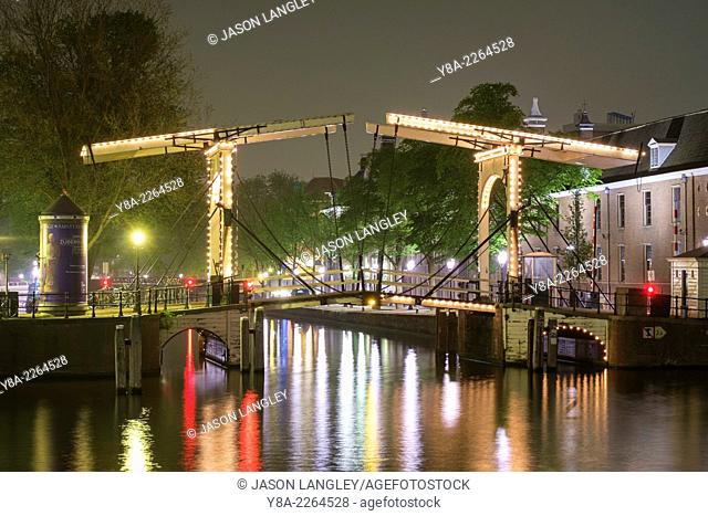 Drawbridge on the river Amstel at night, Amsterdam, North Holland, Netherlands