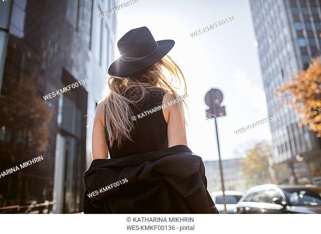 Back view of woman with hat dressed in black
