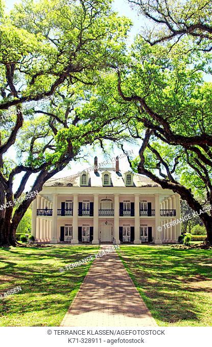 Oak Alley Plantation home with live oak tree canopy in rural Louisianna