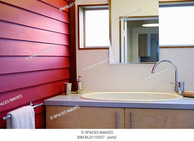 Sink and mirror in modern bathroom