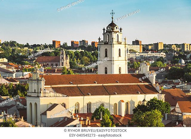 Sunset Sunrise Cityscape Of Vilnius, Lithuania In Summer. Beautiful View Of Old Town In Evening. Sts Johns' Church (Sv. Jonu baznycia)