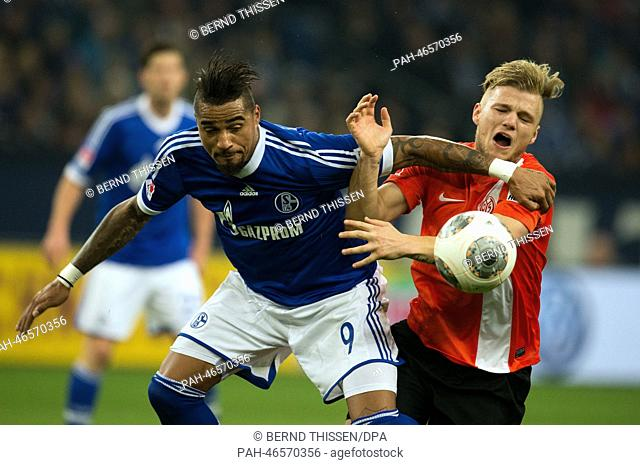 Schalke's Kevin-Prince Boateng and Mainz' Johannes Geis vie for the ball during the soccer Bundesliga match between FC Schalke 04 and FSV Mainz 05 at the...