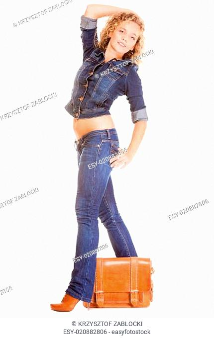 Denim fashion. Full length student girl in blue jeans bag