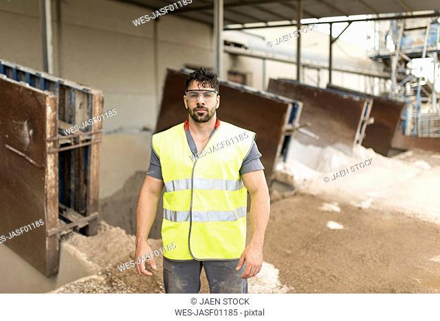 Portrait of worker near to sand deposit