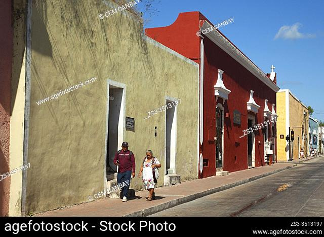 Local people walking in front of the colonial buildings in the city center, Valladolid, Yucatan State, Mexico, Central America