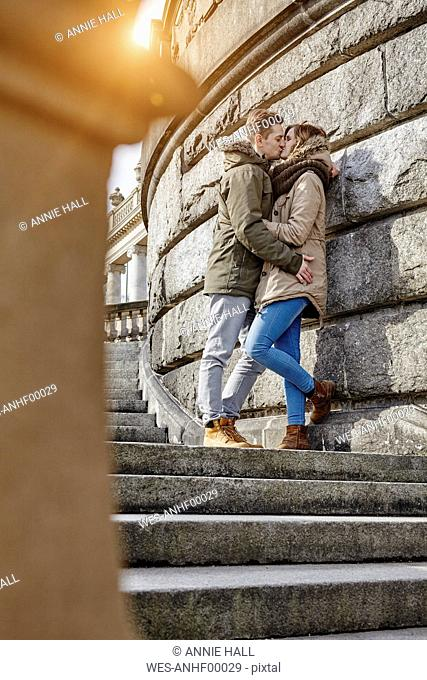 Germany, Potsdam, young couple kissing at Glienicke Bridge