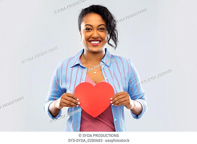 happy african american woman with red heart