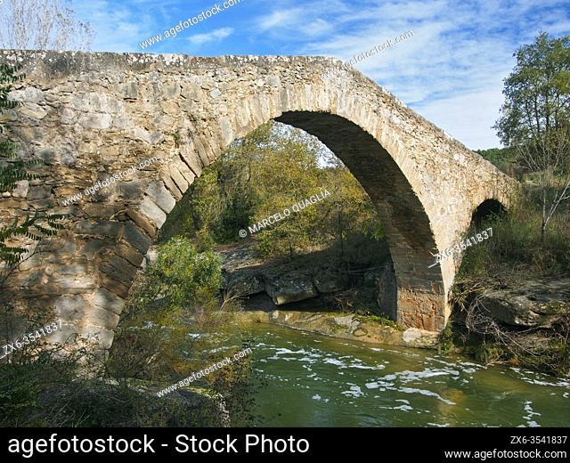 Medieval stone bridge over Merlés stream. Santa María de Merlés village countryside. Lluçanès region, Barcelona province, Catalonia, Spain
