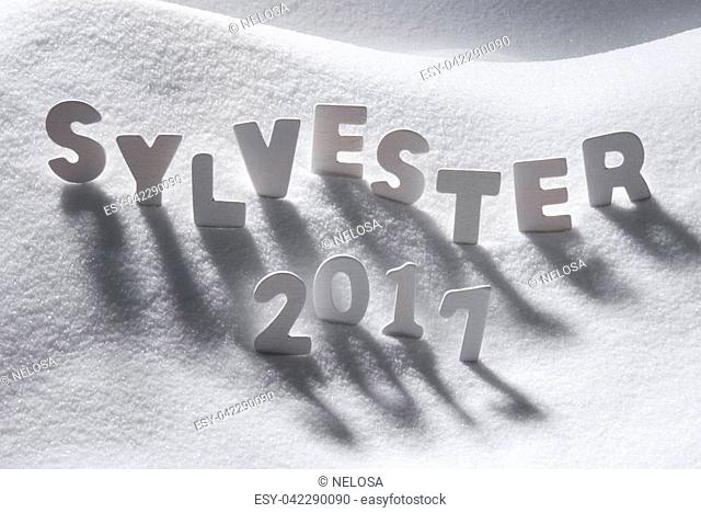 White Letters Building German Text Sylvester 2017 Means New Years Eve 2017 In Snow. Snowy Scenery For Happy New Year Greetings