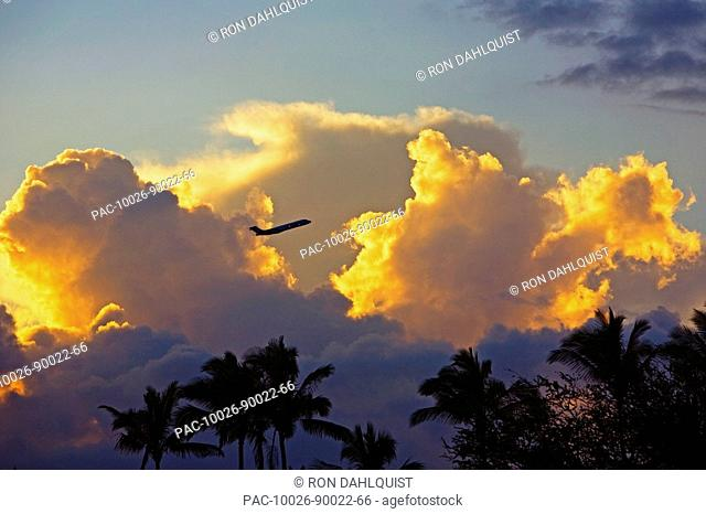 Hawaii, Beautiful clouds a sunset with a silhouette of an airplane