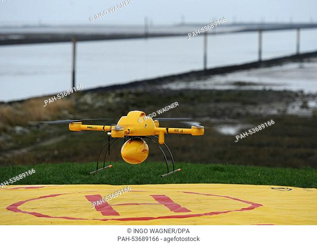 The new DHL 'Paketkopter' drone delivery service begins its flight with medicine over to the island of Juist from Norddeich,Germany, 18 November 2014