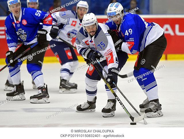 L-R Martin Herman (Pilsen) and Miro Zryd (Zug) in action during the Ice Hockey Champions League group B match: HC Skoda Plzen - EV Zug, in Pilsen