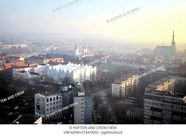 Szczecin Philharmonic Hall, Szczecin, Poland. Architect: Studio Barozzi Veiga, 2014. View from above towards concert hall and city