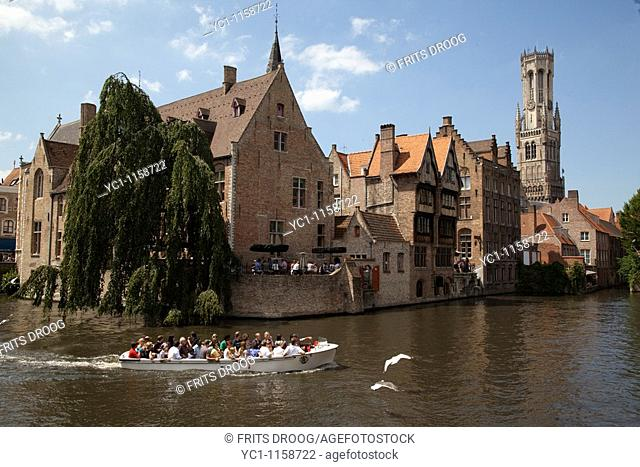 tourists in a little boat in Bruges, Belgium