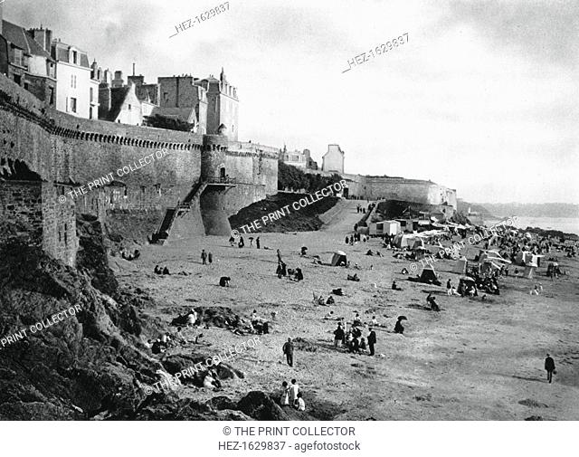 Saint-Malo, France, Brittany, 1937. View of the walled port city and beach with tents for changing into bathing costumes