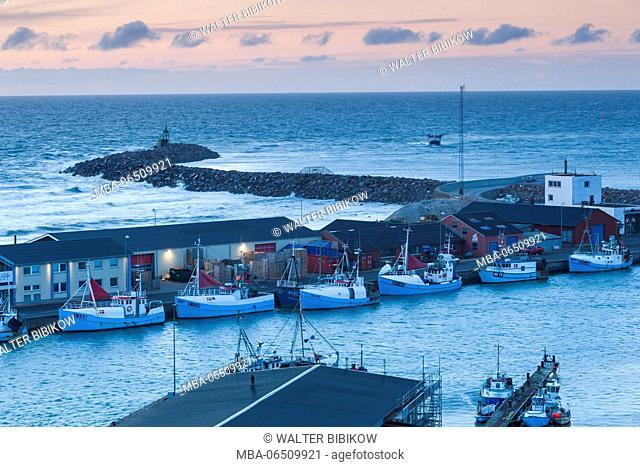 Denmark, Jutland, Hirtshals, elevated fishing port view, dusk