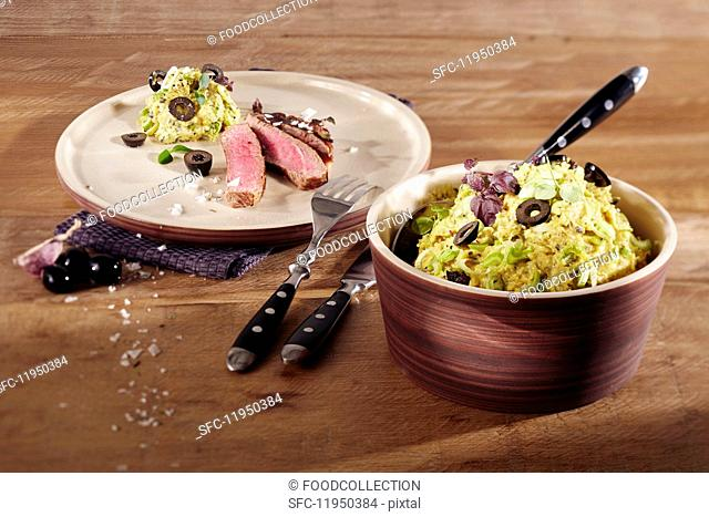 Potato dip with black olives and garlic with beef steak