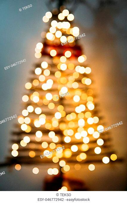 Christmas tree out of focus on a white background