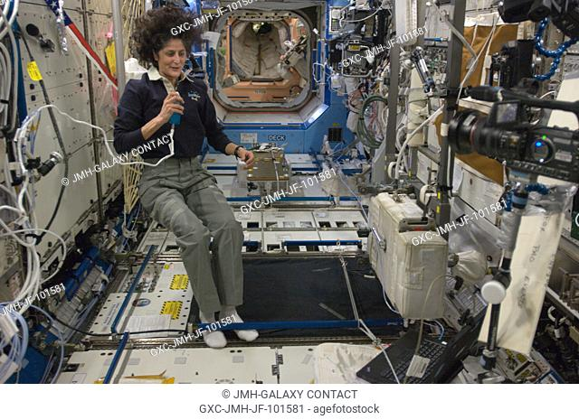 NASA astronaut Sunita Williams, Expedition 33 commander, talks on a microphone in the Destiny laboratory of the International Space Station