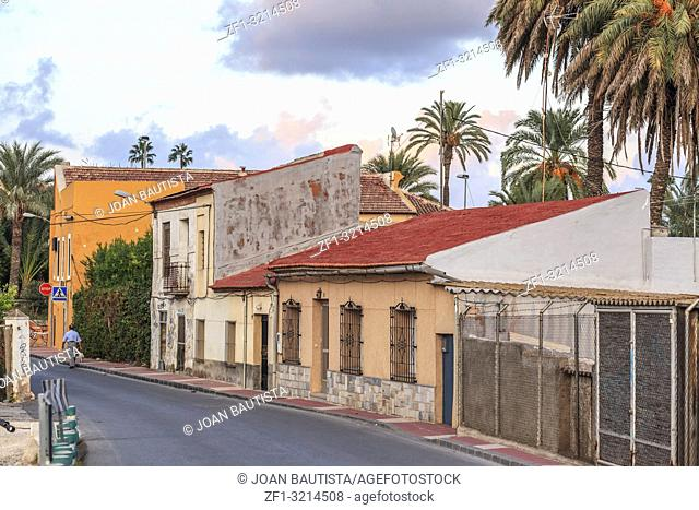 Street view, colored houses and palm trees in Murcia,Spain