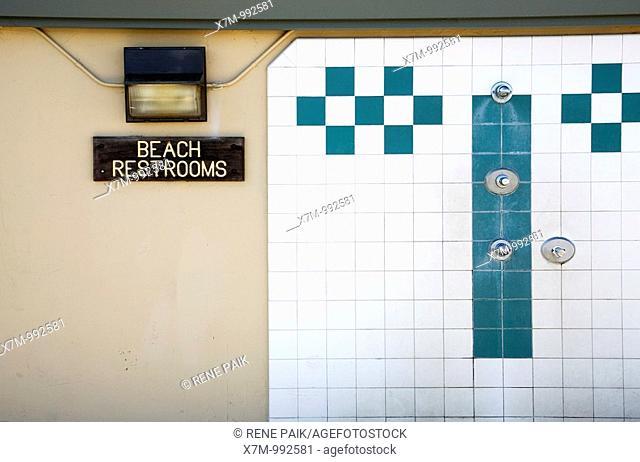 The beach showers next to the restroom sign at Santa Cruz Beach Boardwalk in Santa Cruz, California, USA