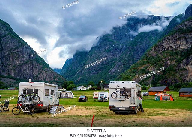 Camper cars at beautiful mountain landscape of Eidfjord. Evening light. Hordaland, Norway