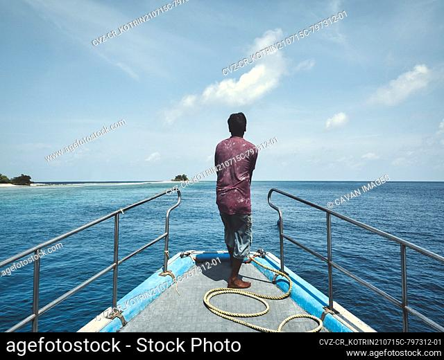 Rear view of fisherman at the boat