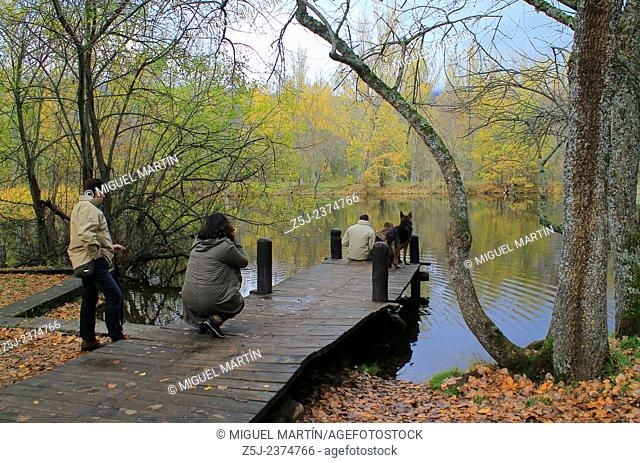A family enjoys the landscape at the pond of the Bosque de Finlandia (Finnish Forest), where a typical Scandinavian landscape has been recreated between some...