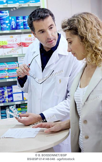 Woman and pharmacist talking