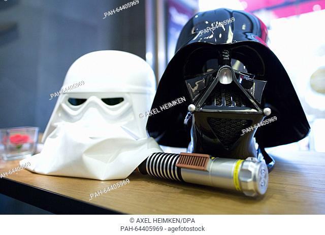 The helmets of Darth Vader (R) and of a Stormtrooper, characters from the Star Wars movies, of members of a local 'Star Wars' fan club are on display in a cafe...