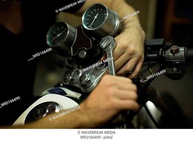 Mechanic tightening motorbike bike handle