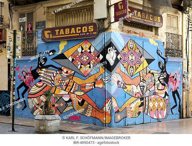 Figures composed of colorful ornaments hold a heart together, wall painting by the Valencian street art artist Disneylexya, Old Town El Carme, Valencia, Spain