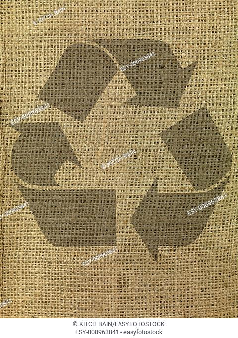 A close up shot of brown hessian cloth with a recycle symbol